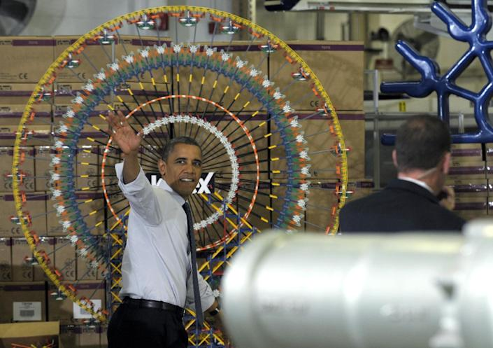 President Barack Obama waves after speaking at the Rodon Group, which manufactures over 95% of the parts for K'NEX Brands toys, Friday, Nov. 30, 2012, in Hatfield, Pa. The visit comes as the White House continues a week of public outreach efforts, while also attempting to negotiate a deal with congressional leaders. (AP Photo/Susan Walsh)