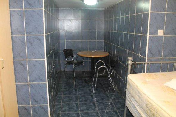 The dining area of the tiled flat.