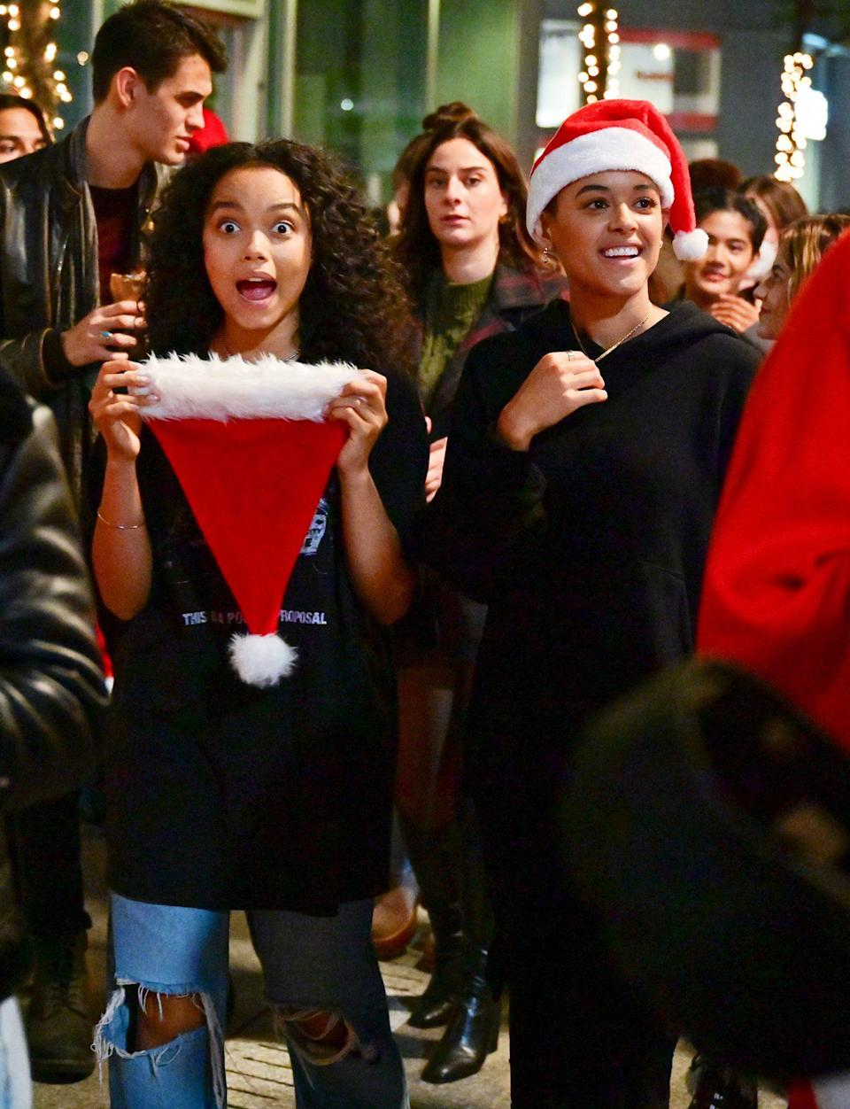 <p>Whitney Peak and Jordan Alexander get into the holiday spirit on the set of <i>Gossip Girl </i>on July 16 in N.Y.C. </p>