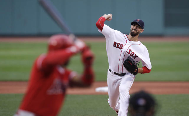Boston Red Sox starting pitcher Rick Porcello delivers during the first inning of the team's baseball game against the Los Angeles Angels at Fenway Park in Boston, Wednesday, June 27, 2018. (AP Photo/Charles Krupa)