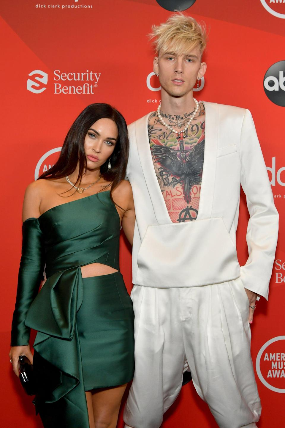 "<p>Megan and Machine Gun Kelly got fans buzzing when they stepped out together in May 2020. A few days after their public outing, <a class=""link rapid-noclick-resp"" href=""https://www.popsugar.com/Brian-Austin-Green"" rel=""nofollow noopener"" target=""_blank"" data-ylk=""slk:Brian Austin Green"">Brian Austin Green</a> confirmed that <a href=""https://www.popsugar.com/celebrity/are-megan-fox-and-brian-austin-green-still-together-47484624"" class=""link rapid-noclick-resp"" rel=""nofollow noopener"" target=""_blank"" data-ylk=""slk:he and Megan had separated"">he and Megan had separated</a> in December 2019, after <a href=""https://www.popsugar.com/celebrity/who-has-megan-fox-dated-47494097"" class=""link rapid-noclick-resp"" rel=""nofollow noopener"" target=""_blank"" data-ylk=""slk:nearly 10 years of marriage"">nearly 10 years of marriage</a>. Megan and MGK further ramped up dating rumors when the rapper dropped his music video for ""Bloody Valentine,"" starring the <strong>Transformers</strong> actress. In June 2020, <a href=""https://www.dailymail.co.uk/tvshowbiz/article-8425303/Megan-Fox-EXCLUSIVE-Actress-confirms-romance-Machine-Gun-Kelly-share-kiss.html"" class=""link rapid-noclick-resp"" rel=""nofollow noopener"" target=""_blank"" data-ylk=""slk:the two basically confirmed their romance"">the two basically confirmed their romance</a> when they were spotted sharing a kiss outside of a bar in LA, and they've shared <a href=""https://www.popsugar.com/celebrity/megan-fox-and-machine-gun-kelly-cute-pictures-47652766"" class=""link rapid-noclick-resp"" rel=""nofollow noopener"" target=""_blank"" data-ylk=""slk:a handful of cute moments"">a handful of cute moments</a> ever since.</p>"