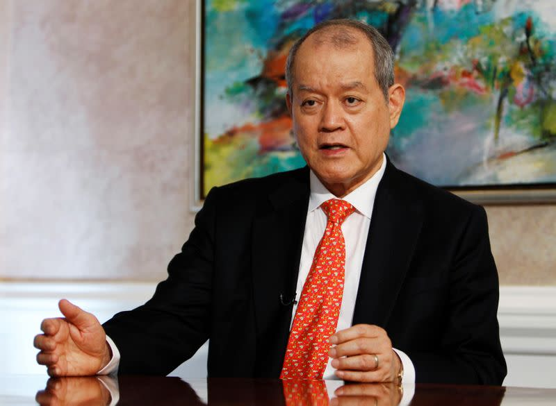 FILE PHOTO: O.K. Lim, founder and chairman of oil trading group Hin Leong, speaks during an interview with Reuters in Singapore