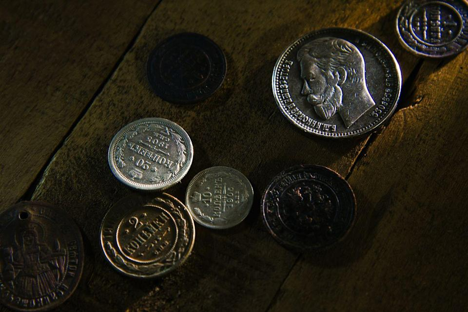 """<p>If you find a dusty piggy bank full of old coins stuck in your basement, look them over carefully. Rare coins can be worth <a href=""""https://moneyinc.com/most-expensive-coins-ever-sold/"""" rel=""""nofollow noopener"""" target=""""_blank"""" data-ylk=""""slk:major money"""" class=""""link rapid-noclick-resp"""">major money</a>, like the Flowing Hair Silver/Copper Dollar 1794/95, which was auctioned for a cool $10 million. But sometimes circulated coins are worth way more than face value—a 1995 U.S. penny with a doubling of the words """"LIBERTY"""" and """"IN GOD WE"""" was sold at auction for more than $5,000.</p>"""