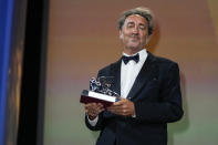 Paolo Sorrentino holds the Silver Lion Grand Jury Prize for 'The Hand Of God' onstage at the closing ceremony during the 78th edition of the Venice Film Festival in Venice, Italy, Saturday, Sept. 11, 2021. (AP Photo/Domenico Stinellis)