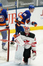 New Jersey Devils goaltender Mackenzie Blackwood (29) reacts as New York Islanders' Brock Nelson (29) skates toward his bench after scoring a goal during the second period of an NHL hockey game Saturday, May 8, 2021, in Uniondale, N.Y. (AP Photo/Frank Franklin II)