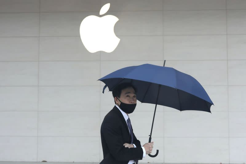 FILE PHOTO: A man walks past an Apple store in Taipei