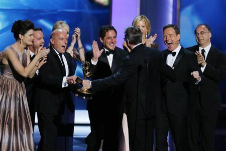 "Cast and crew cheer executive producer Vince Gilligan after he accepted the award for Outstanding Drama Series for ""Breaking Bad"" at the 65th Primetime Emmy Awards in Los Angeles September 22, 2013. REUTERS/Mike Blake"