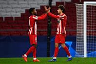 Joao Felix (R) celebrates with Thomas Lemar after scoring twice to help Atletico Madrid to a 3-2 win over Salzburg