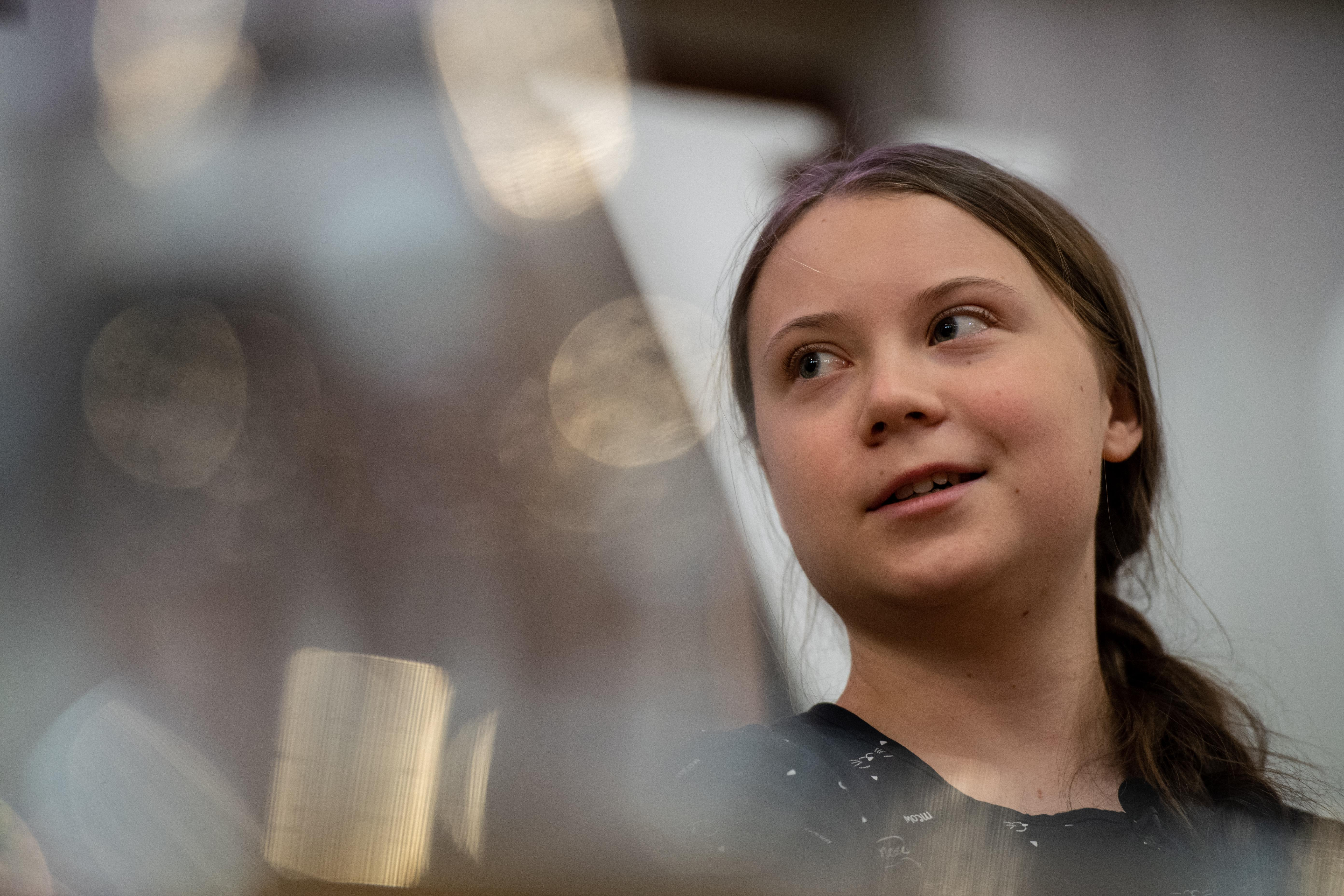 Greta Thunberg speaks at an event with other climate activists in London, England. [Photo: Getty]