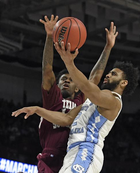 North Carolina's Joel Berry II (2) shoots against Texas Southern's Lamont Walker (14) during the first half in a first-round game of the NCAA men's college basketball tournament in Greenville, S.C., Friday, March 17, 2017. (AP Photo/Rainier Ehrhardt)