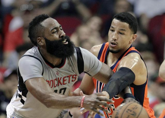 James Harden is defended closely by the Thunder's Andre Roberson. (AP)