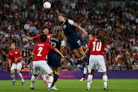 LONDON, ENGLAND - AUGUST 09: Abby Wambach #14 of the United States goes up for a header against Saki Kumagai #4 of Japan during the Women's Football gold medal match on Day 13 of the London 2012 Olympic Games at Wembley Stadium on August 9, 2012 in London, England. (Photo by Julian Finney/Getty Images)