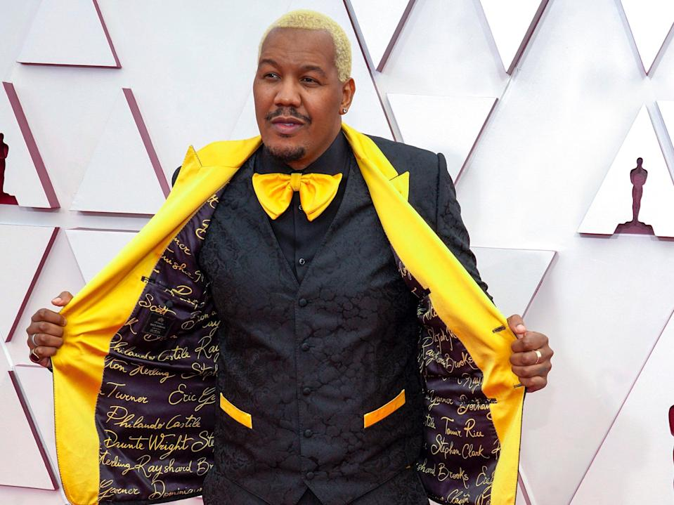 Travon Free wears suit with names of police brutality victims on Oscars red carpet (Getty Images)