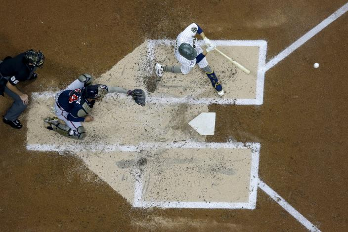 Milwaukee Brewers' Luis Urias hits an RBI single during the second inning of a baseball game against the Milwaukee Brewers Friday, May 14, 2021, in Milwaukee. (AP Photo/Morry Gash)