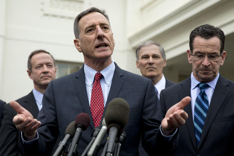 Democratic Governors Association Chairman, Vermont Gov. Peter Shumlin, second from left, speaks to the media outside the White House in Washington, Friday, Feb. 21, 2014, following a meeting President Barack Obama and Vice President Joe Biden. From left are, Maryland Gov. Martin O'Malley, Shumlin, Washington Gov. Jay Inslee, and Connecticut Gov. Dan Malloy. (AP Photo/Jacquelyn Martin)