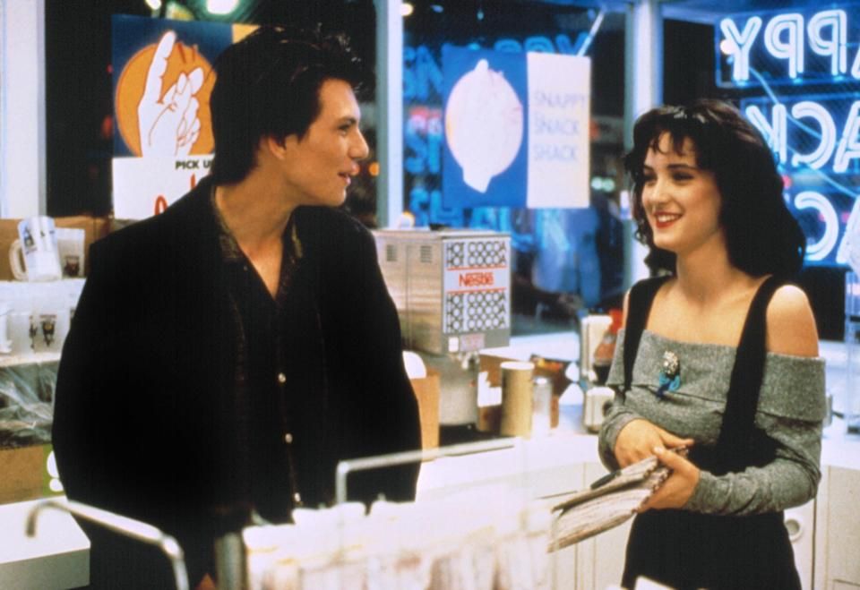 Christian Slater and Winona Ryder laughing inside a store
