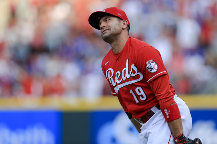 Cincinnati Reds' Joey Votto reacts to teammates after making a catch in foul territory on a ball hit by Chicago Cubs' Kris Bryant for the final out of a baseball game in Cincinnati, Saturday, July 3, 2021. The Reds won 3-2. (AP Photo/Aaron Doster)