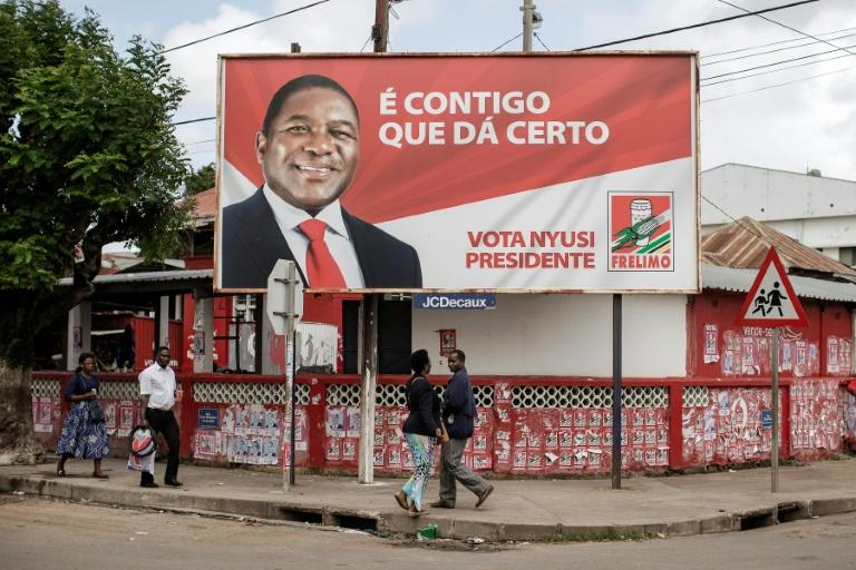 A billboard in Xai-Xai for President Filipe Nyusi, who is running for his second term in office in Tuesday's election (AFP Photo/GIANLUIGI GUERCIA)