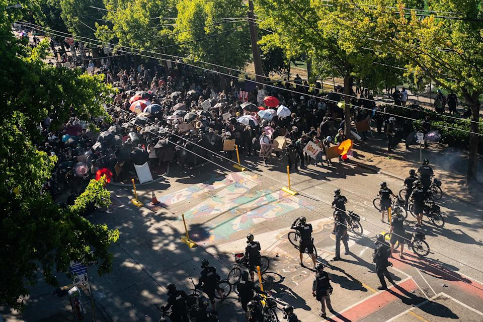 Black Lives Matter protesters face off with police in Seattle, Washington, on July 25, 2020.