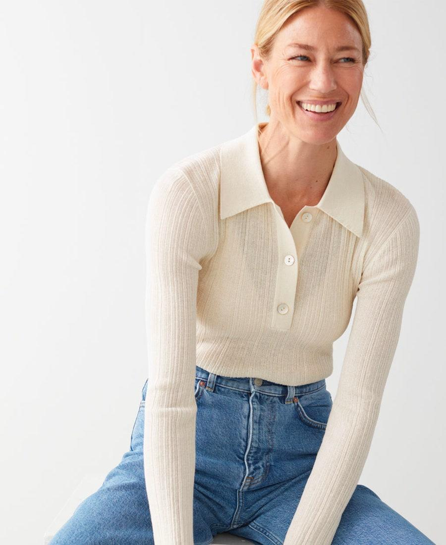 """Channel your inner Diane Keaton with this finely knit polo sweater. $69, & Other Stories. <a href=""""https://www.stories.com/en_usd/clothing/tops/tops-t-shirts/product.sheer-fitted-polo-top-beige.0865864007.html"""" rel=""""nofollow noopener"""" target=""""_blank"""" data-ylk=""""slk:Get it now!"""" class=""""link rapid-noclick-resp"""">Get it now!</a>"""