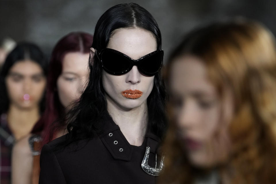 Models wear creations for Acne Studios Spring-Summer 2022 ready-to-wear fashion show presented Wednesday, Sept. 29, 2021, in Paris. (AP Photo/Christophe Ena)