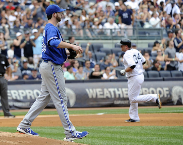 New York Yankees' Brian McCann, right, rounds the bases with a two-run home run as Toronto Blue Jays pitcher Drew Hutchison, left, looks on during the fourth inning of a baseball game Saturday, July 26, 2014, at Yankee Stadium in New York. (AP Photo/Bill Kostroun)
