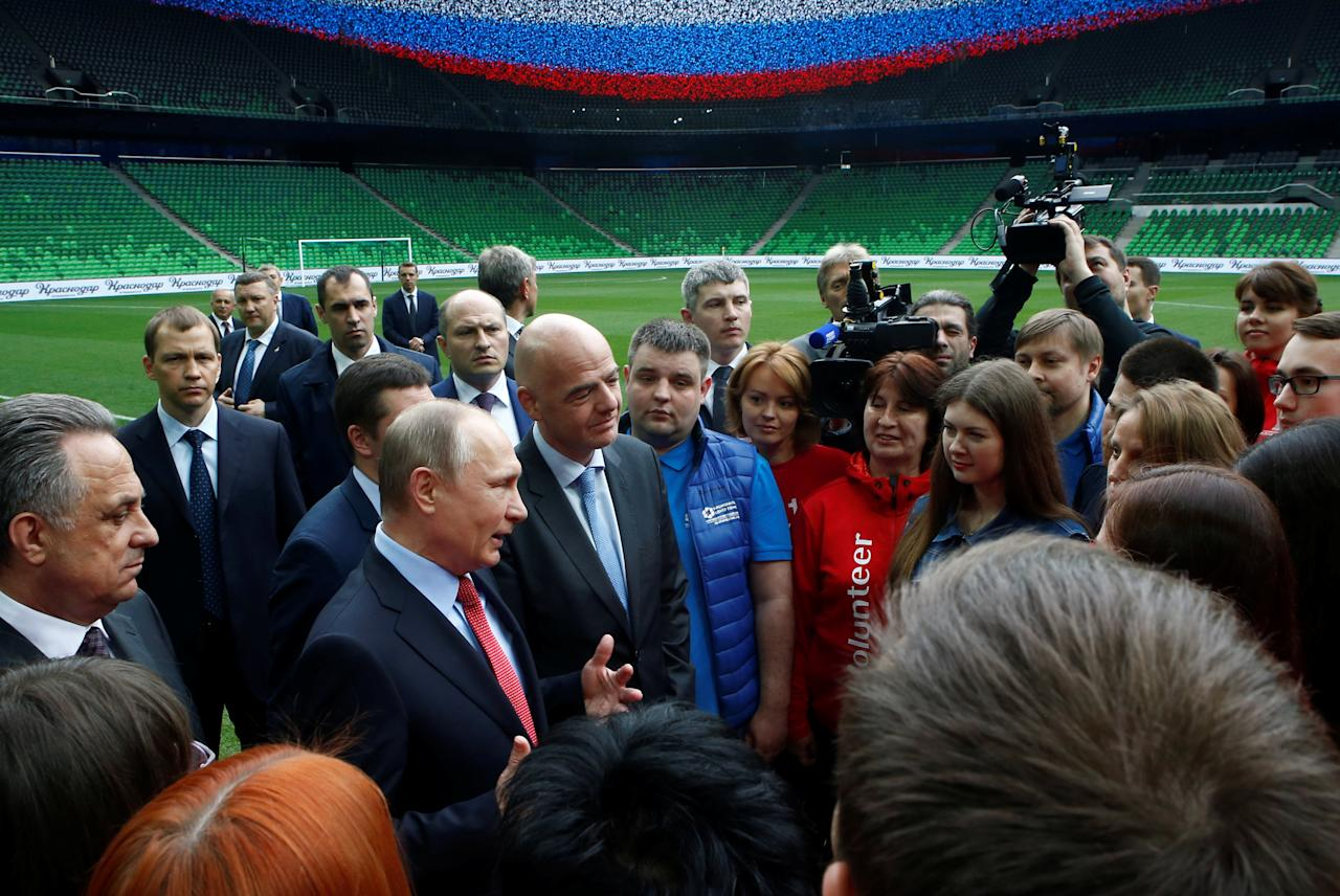 Russian President Vladimir Putin and FIFA President Gianni Infantino meet with members of Russian volunteer associations at the FC Krasnodar Stadium in the southern city of Krasnodar, Russia, May 23, 2017. REUTERS/Sergei Karpukhin