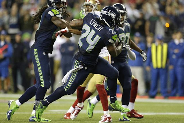 Seattle Seahawks running back Marshawn Lynch (24) runs for a touchdown against the San Francisco 49ers in the second half of an NFL football game, Sunday, Sept. 15, 2013, in Seattle. (AP Photo/Elaine Thompson)