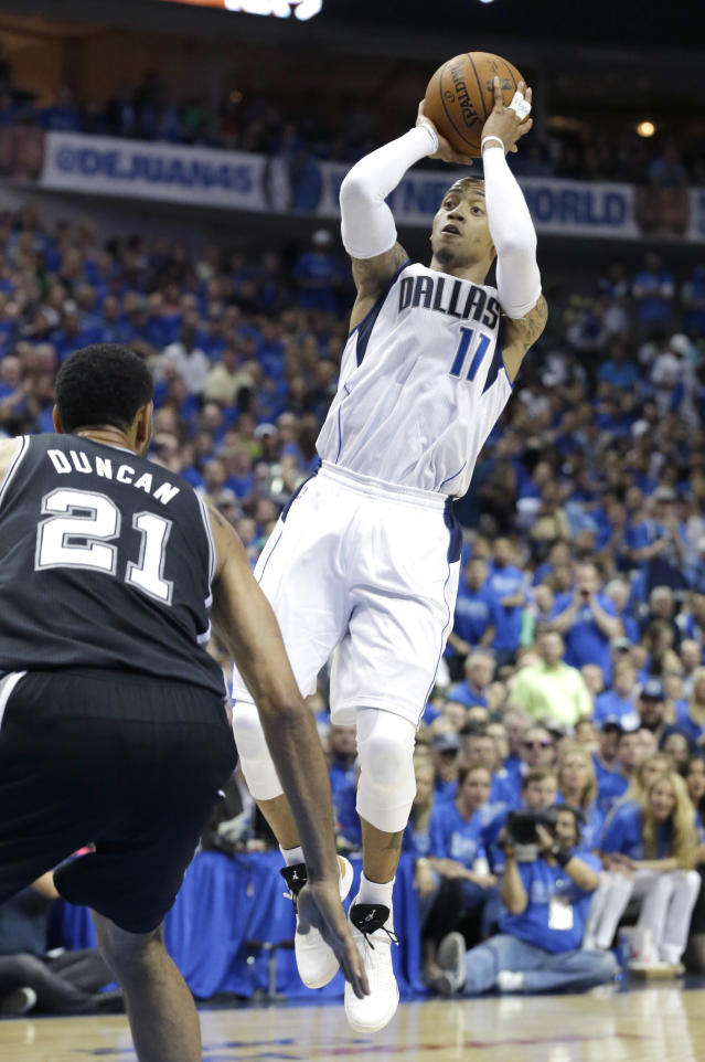 Dallas Mavericks guard Monta Ellis (11) shoots over San Antonio Spurs forward Tim Duncan (21) during the first half in Game 3 in the first round of the NBA basketball playoffs in Dallas, Saturday, April 26, 2014. (AP Photo/LM Otero)