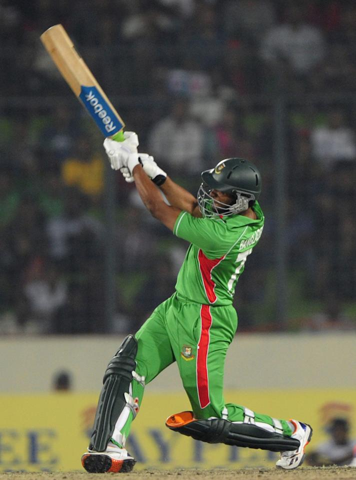 Bangladeshi batsman Shakib Al Hasan plays a shot during the one day international (ODI) Asia Cup cricket match between India and Bangladesh at the Sher-e-Bangla National Cricket Stadium in Dhaka on March 16, 2012. India's Sachin Tendulkar became the first batsman in history to score 100 international centuries, adding another milestone in his record-breaking career. AFP PHOTO/Munir uz ZAMAN (Photo credit should read MUNIR UZ ZAMAN/AFP/Getty Images)