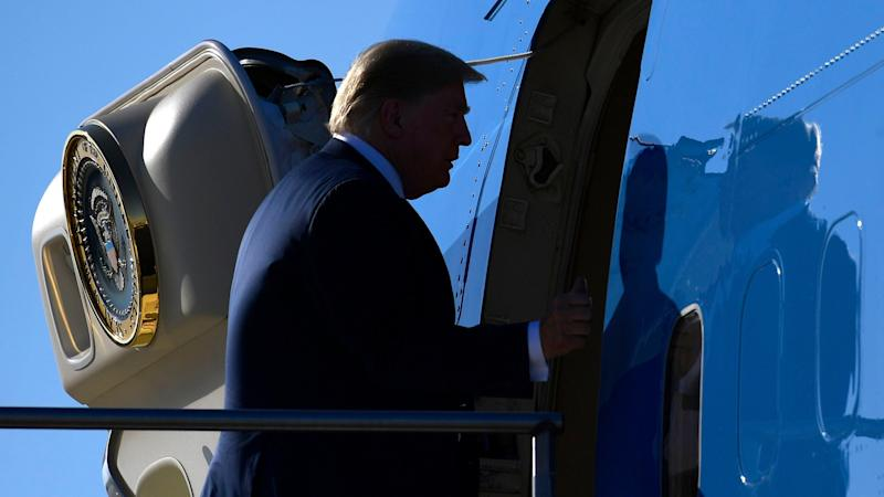 Mandatory Credit: Photo by Susan Walsh/AP/REX/Shutterstock (9876492ac)President Donald Trump walks up the steps of Air Force One at Sioux Falls Regional Airport, in Sioux Falls, S.