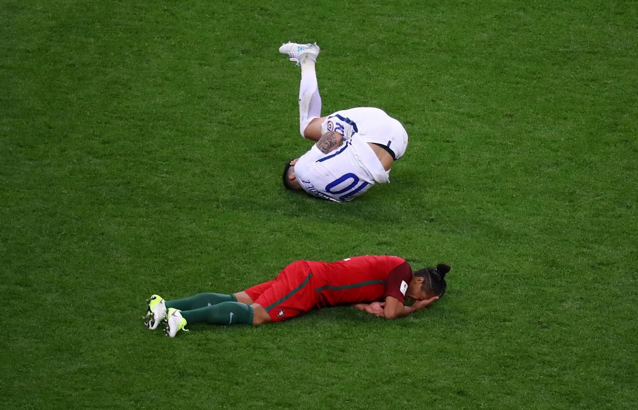 Soccer Football - Portugal v Chile - FIFA Confederations Cup Russia 2017 - Semi Final - Kazan Arena, Kazan, Russia - June 28, 2017   Chile's Pablo Hernandez lies injured with Portugal's Bruno Alves   REUTERS/Kai Pfaffenbach     TPX IMAGES OF THE DAY