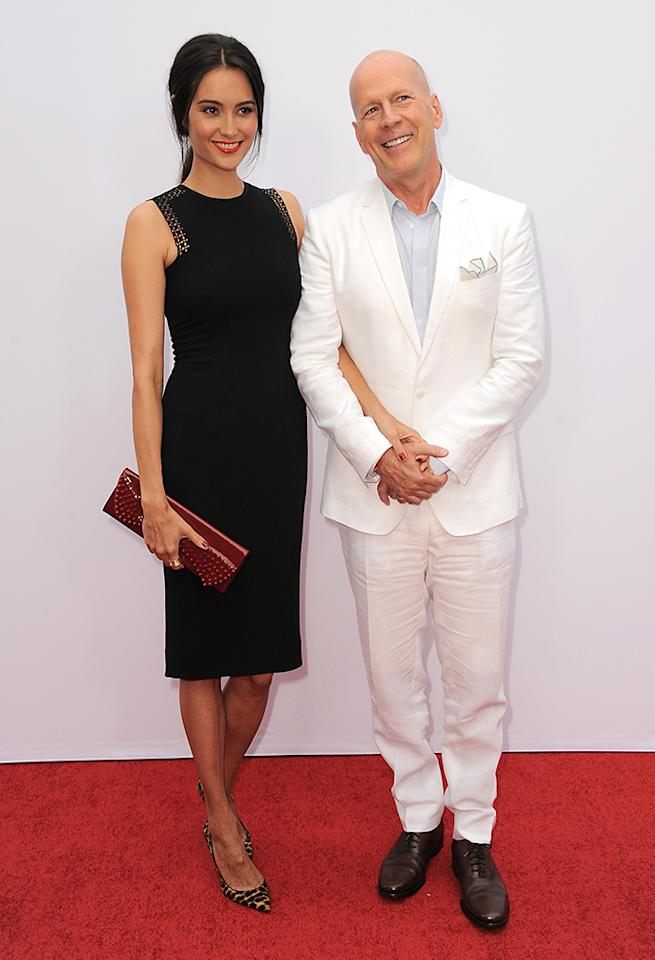 """Bruce Willis, right, and Emma Heming arrive at the LA premiere of """"Red 2"""" at the Westwood Village on Thursday, July 11, 2013, in Los Angeles. (Photo by Jordan Strauss/Invision/AP)"""