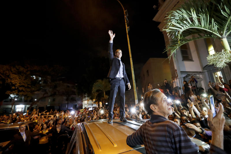 Venezuelan Congress President Juan Guaido greets the crowd after Ash Wednesday Mass celebrations in Caracas, Venezuela, Wednesday, March 6, 2019. The U.S. and more than 50 governments recognize Guaido as interim president, saying President Nicolas Maduro wasn't legitimately re-elected last year because opposition candidates weren't permitted to run. (AP Photo/Eduardo Verdugo)