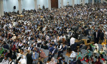 Delegates, attend the last day of an Afghan Loya Jirga or traditional council, in Kabul, Afghanistan, Sunday, Aug. 9, 2020. The council concluded Sunday with hundreds of delegates agreeing to free 400 Taliban members, paving the way for an early start to negotiations between Afghanistan's warring sides. (AP Photo)