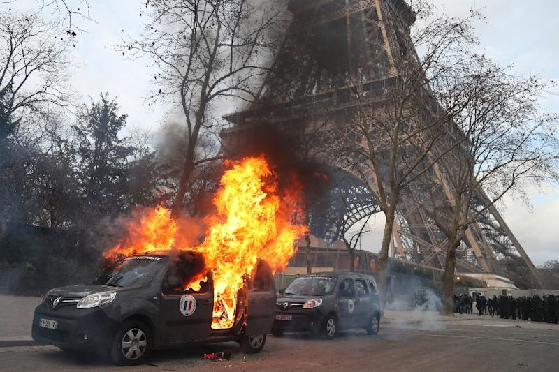 A car belonging to the French anti-terrorism unit Sentinelle was one several cars torched along the route of the 'yellow vests' march (AFP Photo/Zakaria ABDELKAFI)