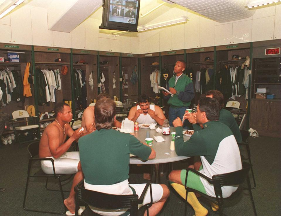 Players from the Oakland Athletics eating dinner in the clubhouse after their final game in the 1994 season. (Getty Images)