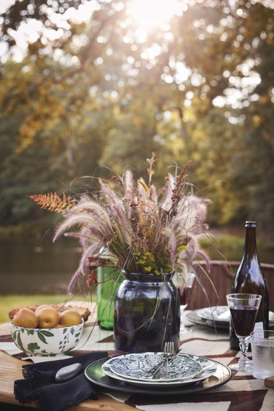 """<p>A centerpiece of fall grasses by <a href=""""https://www.burleigh.co.uk/"""" rel=""""nofollow noopener"""" target=""""_blank"""" data-ylk=""""slk:Burleigh"""" class=""""link rapid-noclick-resp"""">Burleigh</a> and <a href=""""https://www.ralphlauren.com/"""" rel=""""nofollow noopener"""" target=""""_blank"""" data-ylk=""""slk:Ralph Lauren"""" class=""""link rapid-noclick-resp"""">Ralph Lauren</a> with a bowl of apples feels laid-back yet utterly sophisticated for an easy, cool-weather table centerpiece.</p>"""