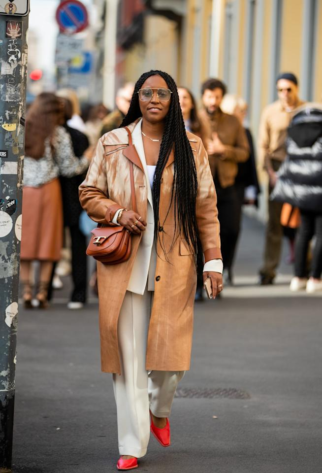 <p>Balance out a long leather trench with a neutral pantsuit underneath, and allow your shoes to provide a pop of color.</p>