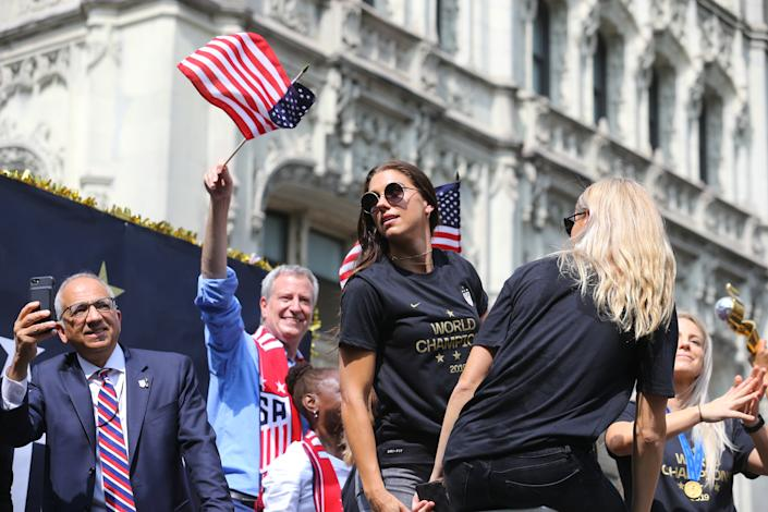 Alex Morgan turns to look at fans in attendance as the U.S. women's soccer team is celebrated with a parade along the Canyon of Heroes, Wednesday, July 10, 2019, in New York. (Photo: Gordon Donovan/Yahoo News)