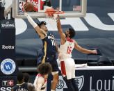 New Orleans Pelicans center Jaxson Hayes (10) dunks over Washington Wizards forward Anthony Gill (16) in the second quarter of an NBA basketball game in New Orleans, Wednesday, Jan. 27, 2021. (AP Photo/Derick Hingle)