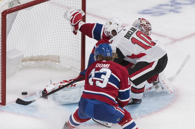 Ottawa Senators' Anthony Duclair (10) scores against Montreal Canadiens goaltender Carey Price as Canadiens' Max Domi defends during second period NHL pre-season hockey action in Montreal, Saturday, Sept. 28, 2019. (Graham Hughes/The Canadian Press via AP)