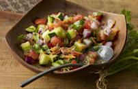 """<p>Not only is this tomato and cucumber salad delicious, you can use its dressing all summer long on any salad. The blend of pepper, garlic powder, olive oil, honey and lime juice is the perfect mix of sweet, tangy and salty flavors.</p> <p><a href=""""https://www.thedailymeal.com/recipes/east-african-fresh-tomato-and-cucumber-salad-recipe?referrer=yahoo&category=beauty_food&include_utm=1&utm_medium=referral&utm_source=yahoo&utm_campaign=feed"""" rel=""""nofollow noopener"""" target=""""_blank"""" data-ylk=""""slk:For the Fresh Tomato and Cucumber Salad recipe, click here"""" class=""""link rapid-noclick-resp"""">For the Fresh Tomato and Cucumber Salad recipe, click here</a>.</p>"""