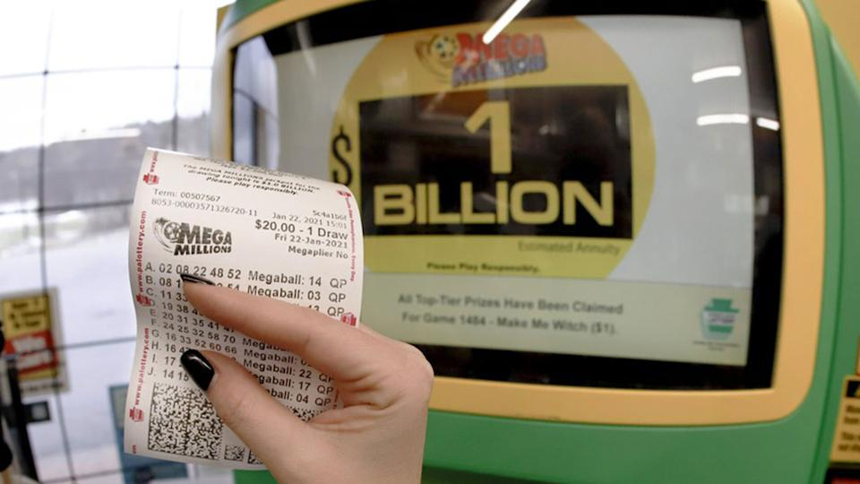 Stock image of woman holding Lotto ticket. Source: AP