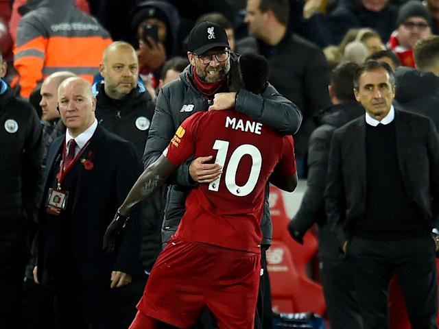 Jurgen Klopp embraces Sadio Mane after Liverpool's win over Manchester City: Getty