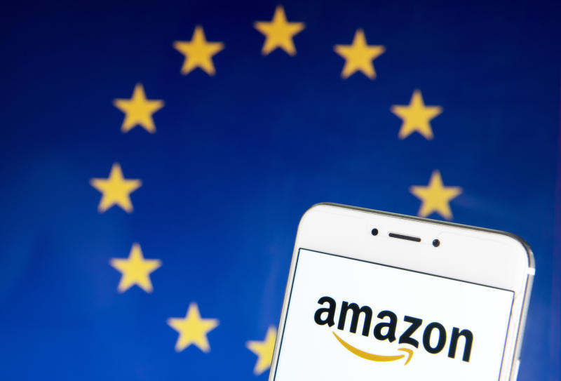 HONG KONG - 2019/04/21: In this photo illustration the American electronic commerce and cloud computing company Amazon logo is seen on an Android mobile device with the European Union (EU) flag in the background. (Photo Illustration by Budrul Chukrut/SOPA Images/LightRocket via Getty Images)