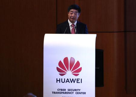FILE PHOTO:  Huawei's Deputy Chairman Ken Hu addresses a speech at the opening of the Huawei Cyber Security Transparency Centre in Brussels, Belgium March 5, 2019.  REUTERS/Yves Herman/File photo