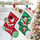"""<p><strong>Disney </strong></p><p>shopdisney.com</p><p><strong>$24.99</strong></p><p><a href=""""https://go.redirectingat.com?id=74968X1596630&url=https%3A%2F%2Fwww.shopdisney.com%2Fmickey-mouse-holiday-stocking-465060000559.html&sref=https%3A%2F%2Fwww.goodhousekeeping.com%2Fholidays%2Fchristmas-ideas%2Fg4621%2Fdisney-stockings%2F"""" rel=""""nofollow noopener"""" target=""""_blank"""" data-ylk=""""slk:Shop Now"""" class=""""link rapid-noclick-resp"""">Shop Now</a></p><p>Keep it classic with these embroidered stockings, which come in Mickey and Minnie prints for a sweet his-and-hers set. </p>"""