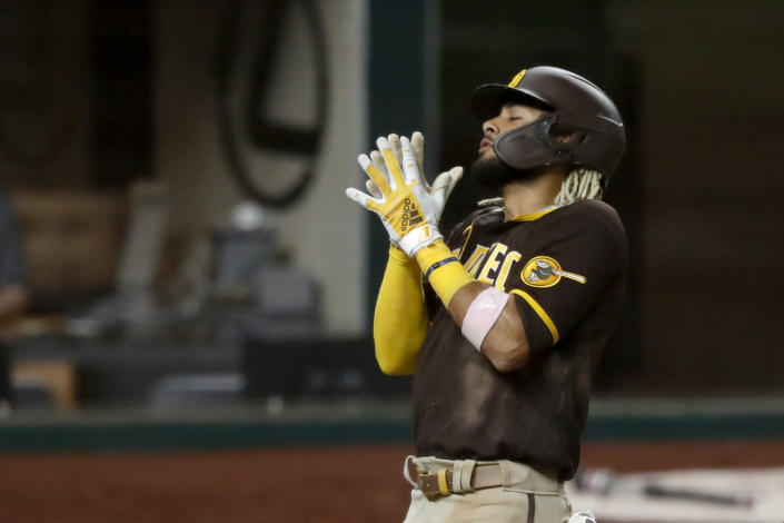 Padres star Fernando Tatis Jr. hit a grand slam for his second homer of Monday's game, only to become embroiled in a discussion of whether swinging at a 3-0 pitch violated unwritten rules. (AP Photo/Tony Gutierrez)