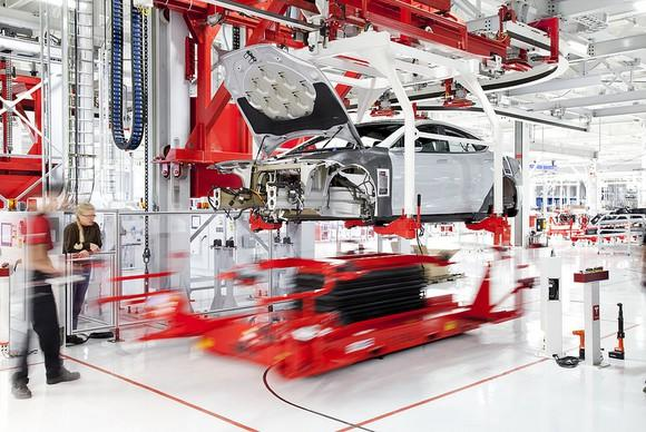 Vehicle being assembled in Tesla's factory.